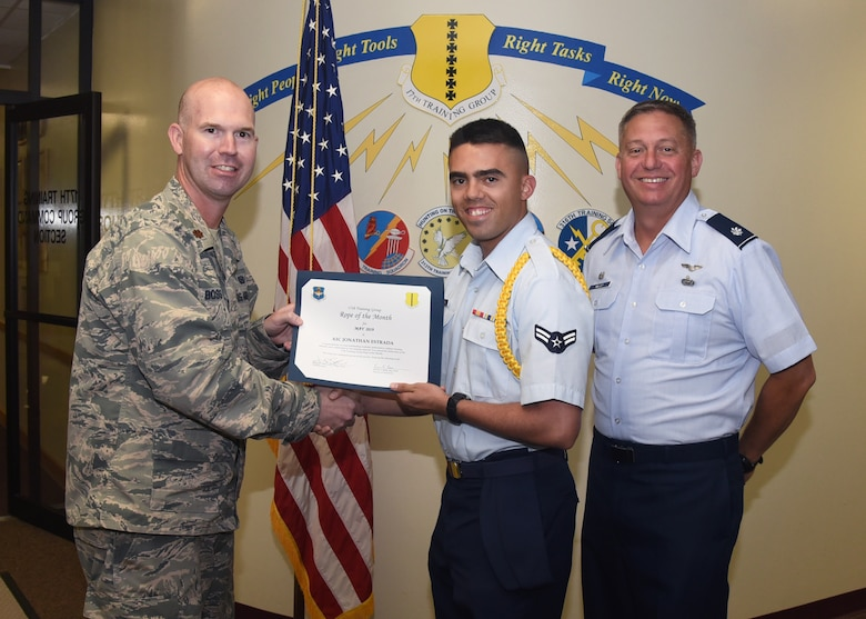 U.S. Air Force Maj. Kevin Boss, 17th Training Group director of operations, presents the Rope of the Month award to Airman 1st Class Jonathon Estrada, 315th Training Squadron student at the Brandenburg Hall on Goodfellow Air Force Base, Texas, June 7, 2019. Military Training Leaders present ropes to Airmen who display exceptional leadership qualities to lead their peers. (U.S. Air Force photo by Airman 1st Class Abbey Rieves/Released)