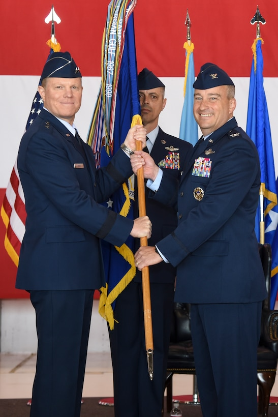 Col. Alain D. Poisson, right, accepts the guideon for the 552nd Air Control Wing from Maj. Gen. Andrew A. Croft, 12th Air Force (Air Forces Southern) commander, during the change of command ceremony June 10, 2019, Tinker Air Force Base, Oklahoma. Col. Geoffrey Weiss relinquished command of the 552 ACW to Col. Alain D. Poisson. (U.S. Air Force photo/Greg L. Davis)
