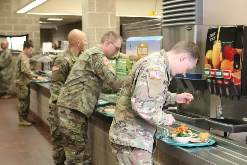 Troops line up to get food.