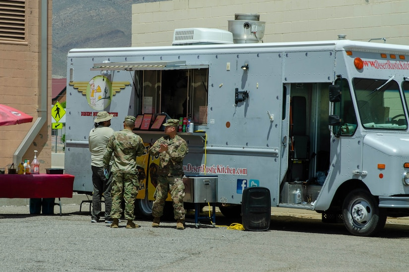 Soldiers order from a food truck.