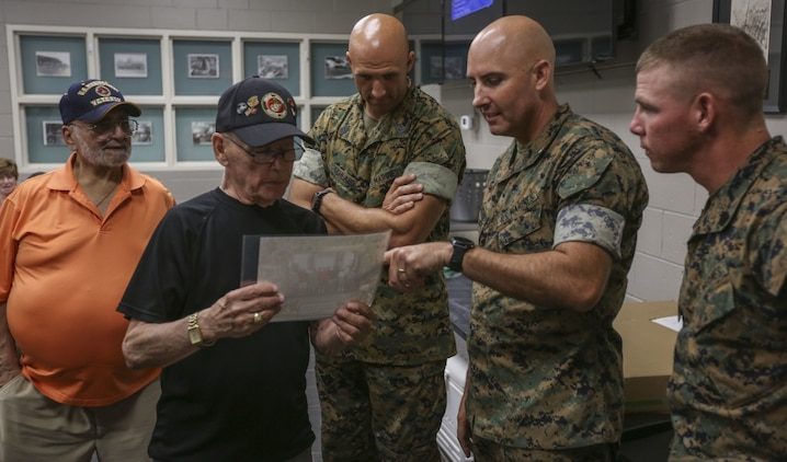 Drill instructors and command leadership from 2nd Recruit Training Battalion enjoy fellowship with Marines from the Parris Island Recruit Training graduating class of 1955 at the Brig and Brew on Parris Island, S.C. June 6th, 2019. Approximately 20 former members of 2nd Recruit Training Battalion attended the gathering to share memories of when they attended Recruit Training. The group has reunited several times in the past, but this year's reunion was the first to be held at the depot.