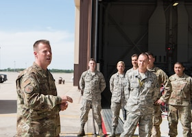 Chief Master Sgt. Charles R. Hoffman, the command chief of Air Force Global Strike Command from Barksdale Air Force Base, Louisiana, speaks to Airmen with the 509th and 131st Bomb Wings after touring a B-2 Spirit on June 11, 2019, at Whiteman Air Force Base, Missouri. The Airman taught him about their roles on base and the jobs that they all do throughout the day during his total immersion tour of the base. (U.S. Air Force Photo by Airman 1st Class Parker J. McCauley)