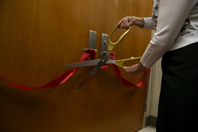 Jude Weston Step Mother of Maj. Michael E. Weston cut the ribbon off the doors to officially open the courtroom during the dedication ceremony for her stepson Maj. Michael Weston at the Marine Corps Recruit Depot Parris Island, S.C. June 11, 2019. Marines, Family, and friends gathered at the ceremony to pay Homage to the Marine by dedicating a court room to him.