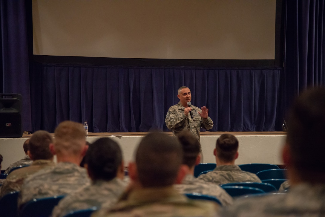 Chief Master Sgt. Kahn Scalise, the 302nd Airlift Wing command chief, addresses junior Reserve Citizen Airmen during an enlisted town hall meeting in the base theater June 1, 2019 at Peterson Air Force Base, Colorado.