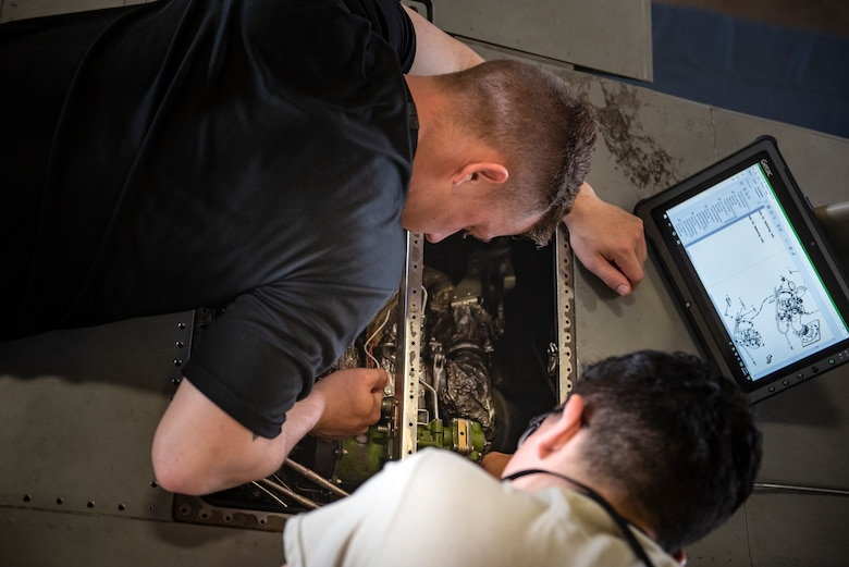 Airman Grantham Dorriety, left, and Airman Gregory Herrera, 364th Training Squadron electrical and environmental systems apprentice course students, remove a backup bleed air valve at Sheppard Air Force Base, Texas, June 14, 2019. The backup bleed air valve controls the air pressure for the air conditioning unit in the flight-deck, without proper air pressure the pilot could pass out. Once the students remove the valve they will learn how to re-install it. (U.S. Air Force photo by Airman 1st Class Pedro Tenorio)