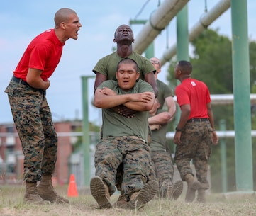 Recruits with Bravo Company, 2nd Recruit Training Battalion, complete numerous challenges during the Obstacle Course on Marine Corps Recruit Depot Parris Island, South Carolina, May 30, 2019. This event is comprised of various obstacles and is designed to help recruits build confidence by overcoming physical challenges. (U.S. Marine Corps photo by Lance Cpl. Dylan Walters)