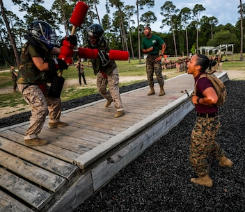 Recruits with Papa Company, 4th Recruit Training Battalion, engage pugil sticks at Marine Corps Recruit Depot Parris Island, S.C., May 31, 2019. Body sparring and pugil sticks help recruits apply the fundamentals of Marine Corps martial arts. (U.S. Marine Corps Photo by Cpl. Andrew Neumann)