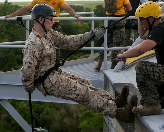 A recruit with Fox Company, 2nd Recruit Training Battalion, practices rappelling on Marine Corps Recruit Depot Parris Island, S.C., June 10, 2019. Recruits rappel from the 47-foot-tall tower wearing a safety harness, helmet and gloves to gain confidence and overcome any fear of heights. (U.S. Marine Corps photo by Pfc. Michelle Brudnicki/Released)