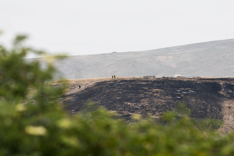 30th Space Wing firefighters work with the Santa Barbara Fire Department to mitigate the Rancho Fire June 14, 2019, at Vandenberg Air Force Base, Calif. The fire burned approximately 140 acres near Point Sal and El Rancho roads. (U.S. Air Force photo by Airman 1st Class Hanah Abercrombie)