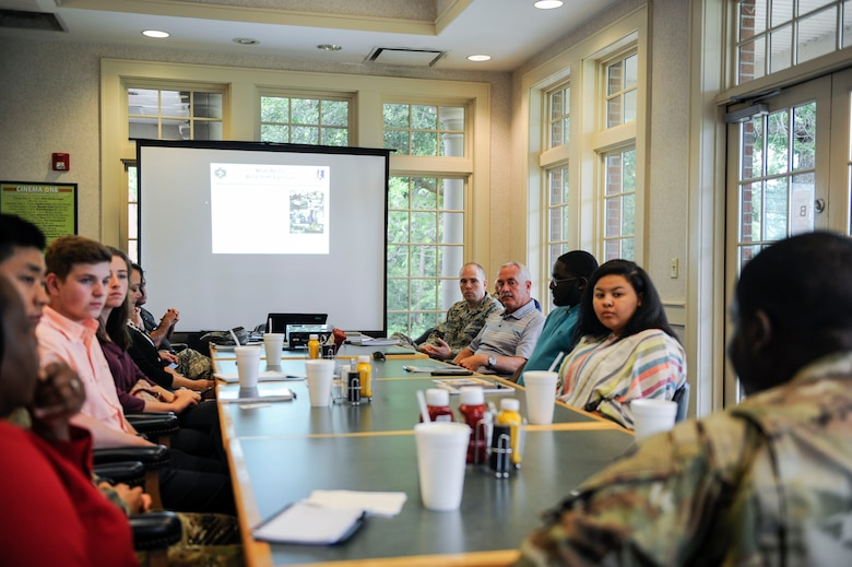 The inaugural participants in the new Summer Intern Program attend an orientation briefing June 10, 2019, at the Wrenwoods Golf Course at Joint Base Charleston, S.C.