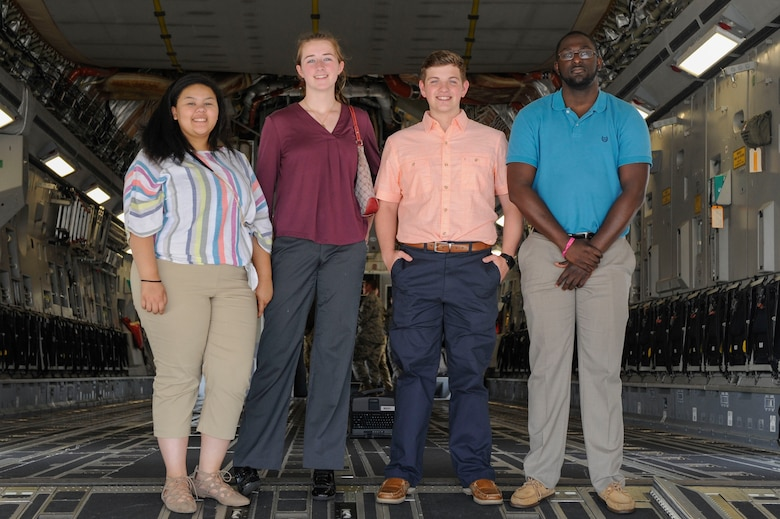 Left to right: Rachel Higgins, Emma McBride, Aleric Stell and Brandon Harvey, participants in the new Summer Intern Program, stand on the ramp of a C-17 Globemaster III during a tour of Joint Base Charleston, S.C., June 10, 2019.