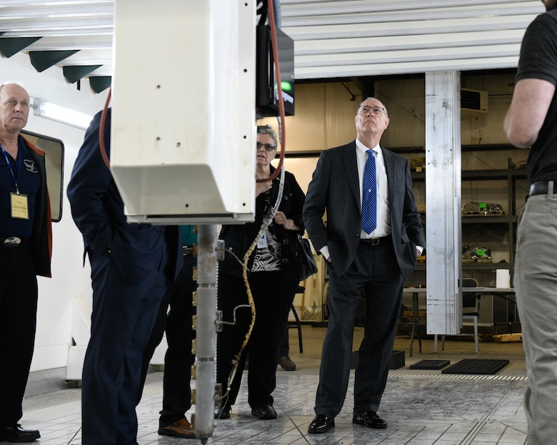 Retired Col. Joe Zeis, the Senior Advisor for Aerospace and Defense for the Ohio Governor's Office, inspects a Big Area Additive Manufacturing 3d printer during a tour of M7 Technologies, Youngstown, Ohio, June 13, 2019.