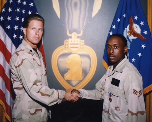 Lt. Col. Doug Cochran, 58th Fighter Squadron commander, presents Senior Airman Lee Wright with the Purple Heart for his actions following the KhobarTowers attack during a ceremony July 1996 at Eglin Air Force Base, Florida. (U.S. Air Force photo)
