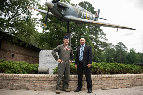 Maj. Tyler Stark, left, 333rd Fighter Squadron assistant director of operations, and Dr. Mike Clumpner, right, President and Chief Executive of Threat Suppression Inc., pose for a photo before an active shooter seminar June 6, 2019, at Seymour Johnson Air Force Base, North Carolina. Both Stark and Clumpner exchanged information on the Columbine shooting from 1999. Stark was a high school student during the tragedy. (U.S. Air Force photo by Senior Airman Miranda A. Loera)