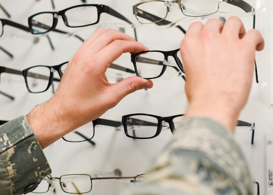 U.S. Air Force Staff Sgt. Jordan Cutaia, 325th Medical Group optometry technician, picks out glasses June 6, 2019, at Tyndall Air Force Base, Florida. Cutaia was named the Air Force Ophthalmic Airman of the Year for 2019. (U.S. Air Force photo Airman 1st Class Alexandra Singer)
