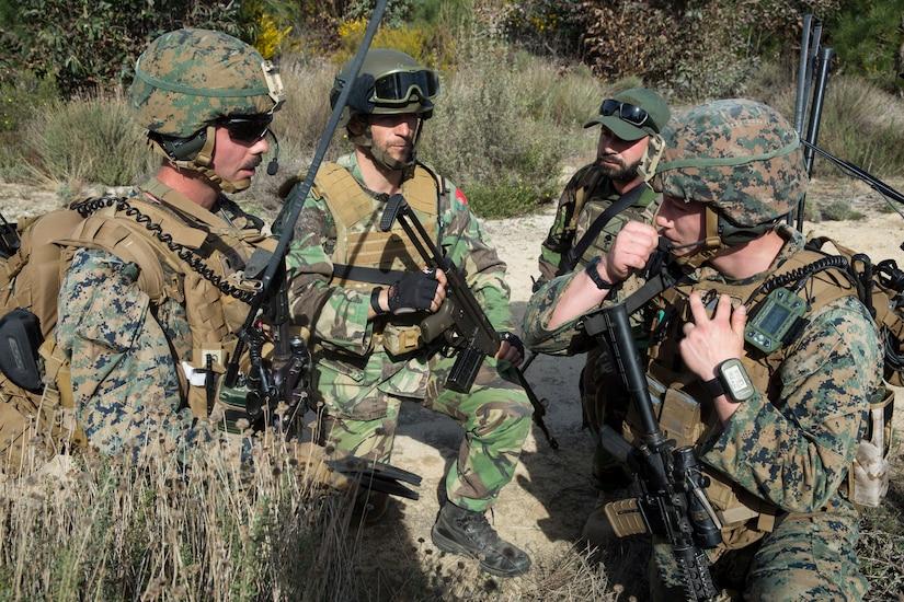 Marines under cover speak.
