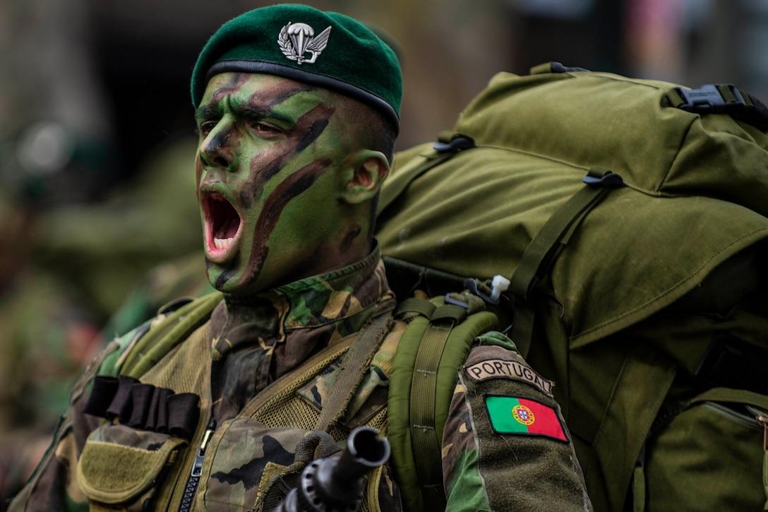 Portuguese soldier shouts.