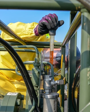 Tech. Sgt. Travis Powers, fuel specialist assigned to the 134th Air Refueling Wing, Tennessee Air National Guard, measures and adds fuel additives into a fuel additive injection cart, June 9, 2019, during exercise Saber Guardian 19 at Burgas Airport, Bulgaria. The USEUCOM, NATO exercise promotes regional stability and security while increasing readiness, strengthening partner capabilities and fostering trust. While training with regional allies and partners, the U.S. presence will continue to galvanize our commitment to security throughout the Black Sea and Balkan regions. (U.S. Air National Guard photo by Tech. Sgt. Daniel Gagnon)