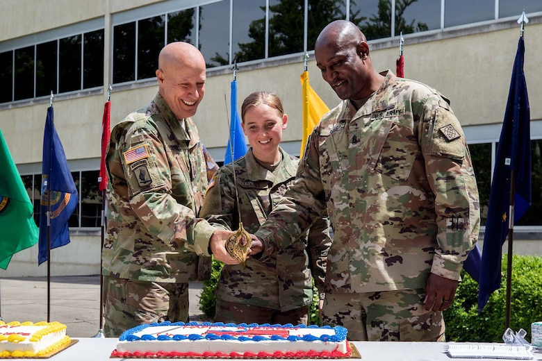Maj. Gen. David C. Coburn, U.S. Army Financial Management Command commanding general, left; Spc. Kayla Adkins, 384th Military Police Company, center; and Command Sgt. Maj. Courtney Ross, USAFMCOM command sergeant major, cut a birthday cake during a ceremony celebrating both the 244th Army birthday and the 244th birthday of the Army Finance Corps at the Maj. Gen. Emmett J. Bean Federal Center in Indianapolis June 14, 2019. It is an Army tradition that the youngest Soldier available at an Army birthday celebration help the commander and sergeant major cut a cake, and Adkins was the youngest at 22 years old. (U.S. Army photo by Mark R. W. Orders-Woempner)
