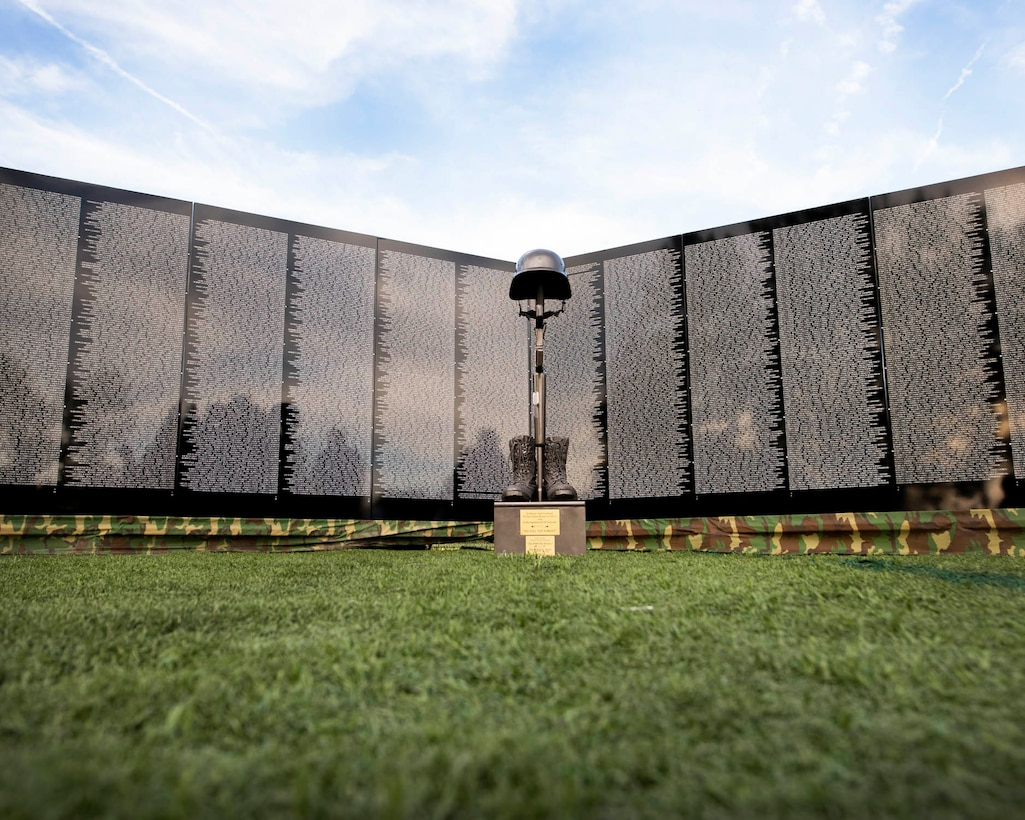 """The sun sets on """"The Moving Wall"""" following the opening ceremony for the display June 13, 2019 in Medical Lake, Wash. The Moving Wall is a half-size replica of the Vietnam Memorial that stands in Washington D.C. It travels throughout the country to bring the experience of visiting the memorial to those who may not have the opportunity to travel to the nation's capital and will be in Medical Lake June 13-17 at the 200 block of South Prentis St. (U.S. Air National Guard photo by Staff Sgt. Rose M. Lust/Released)"""