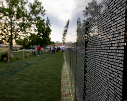 "The sun sets on ""The Moving Wall"" following the opening ceremony for the display June 13, 2019 in Medical Lake, Wash. The Moving Wall is a half-size replica of the Vietnam Memorial that stands in Washington D.C. It travels throughout the country to bring the experience of visiting the memorial to those who may not have the opportunity to travel to the nation's capital and will be in Medical Lake June 13-17 at the 200 block of South Prentis St. (U.S. Air National Guard photo by Staff Sgt. Rose M. Lust/Released)"