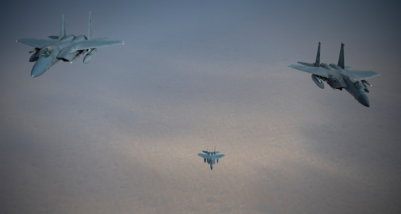 A photo of US and Saudi Air Forces F-15s flying together.