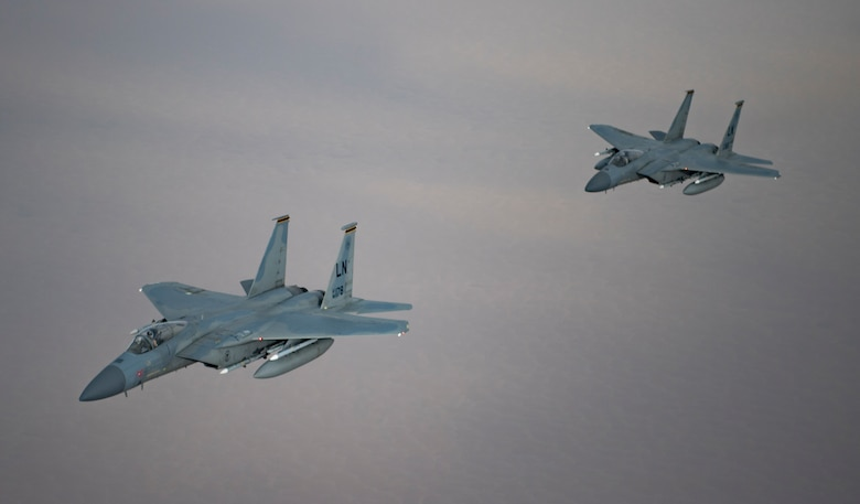 A photo of US and Saudi Air Forces F-15 flying together.