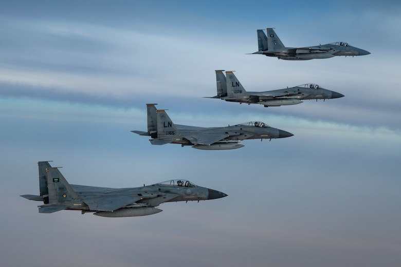 A photo of US and Saudi Air Force F-15Cs flying together in formation