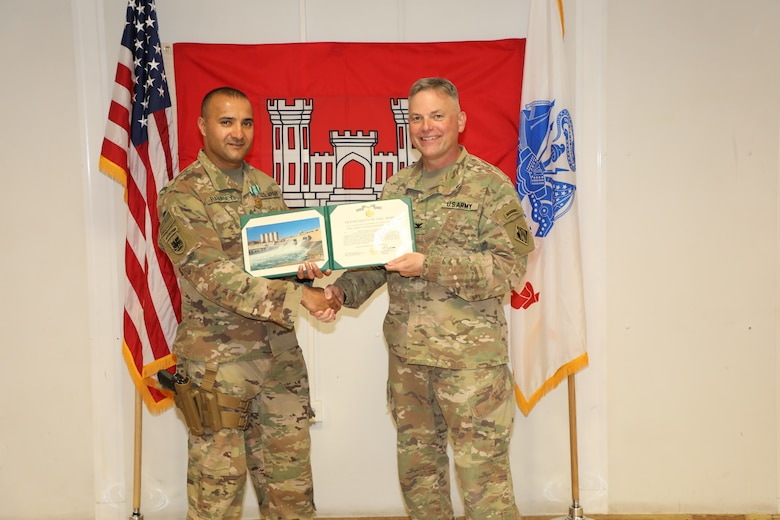 "SFC Amit Ranadey (left) is presented with an Army Commendation Medal by U.S. Army Corps of Engineers Mosul Dam Task Force Commander Col. Philip Secrist during a ceremony held in Mosul, Iraq on June 14, 2019. Ranadey served in multiple roles on the MDTF. In addition to managing Task Force supply and logistics, he was instrumental in the Project's Integration program training Iraqi Ministry of Water Resources personnel in up-to-date processes and technology related to warehouse management and supply accountability. Mosul Dam is a well-designed and well-constructed dam that is unique in that it requires continuous maintenance grouting operations due to the geology under the dam. USACE arrived at Mosul Dam in September 2016 to serve as ""the Engineer"" providing construction management, quality assurance, engineering and technical oversight and project management services in connection with a contract between Iraq and an Italian company for maintenance grouting and rehabilitation of the bottom outlet of the Mosul Dam."