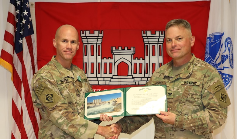 "1st Lt. Brian Warren (left) is presented with an Army Commendation Medal by U.S. Army Corps of Engineers Mosul Dam Task Force Commander Col. Philip Secrist during a ceremony held in Mosul, Iraq on June 14, 2019. Warren served as both the Force Protection Officer (FPO) and the primary Battle Captain where he controlled all movement of Task Force personnel to and from the work site, to and from Kuwait, and via tactical air movement to and from Erbil. Mosul Dam is a well-designed and well-constructed dam that is unique in that it requires continuous maintenance grouting operations due to the geology under the dam. USACE arrived at Mosul Dam in September 2016 to serve as ""the Engineer"" providing construction management, quality assurance, engineering and technical oversight and project management services in connection with a contract between Iraq and an Italian company for maintenance grouting and rehabilitation of the bottom outlet of the Mosul Dam."