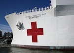 U.S. Navy Hospital Ship USNS Comfort (T-AH 20) gets underway from Naval Station Norfolk, June 14.
