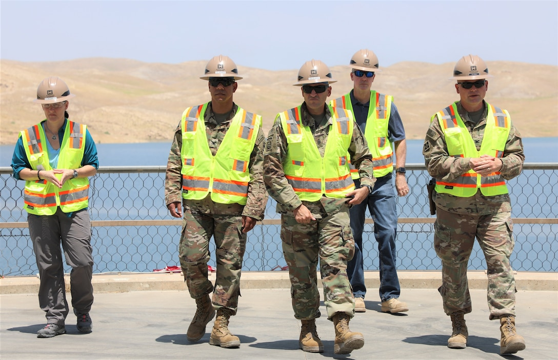Members of the U.S. Corps of Engineers Transatlantic Division leadership team taking a tour at the Mosul Dam, outside the City of Mosul in Iraq, on June 14, 2019. Pictured left to right are: MDTF Project Executive Tambour Eller, TAD Commander Col. Mark Quander, TAD Command Sergeant Major Randolph Delapena, Resident Engineer Steve Kelley, and MDTF Commander Col. Philip Secrist.  USACE is part of a joint venture started in 2016 among the Iraq Ministry of Water Resources, the U.S. Government and Italian Company Trevi S.p.A, charged with stabilizing and repairing the infrastructure of the Mosul Dam. The dam is the largest in Iraq, and the fourth largest in the Middle East. It supplies water, hydropower, irrigation and flood control to the region.