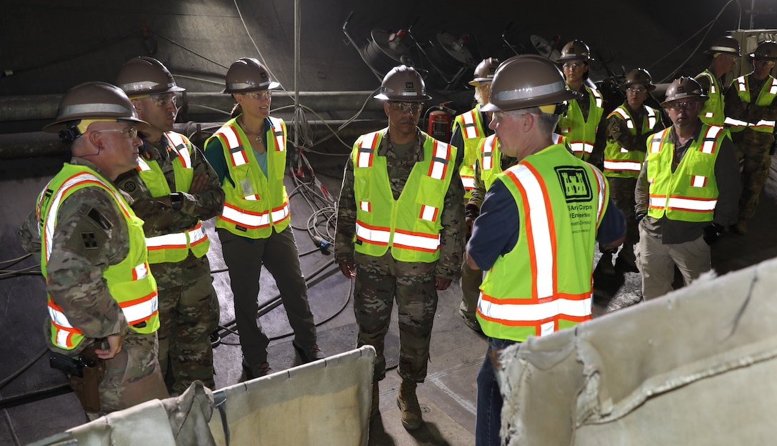 Members of the U.S. Corps of Engineers Transatlantic Division leadership team and members of the Mosul Dam Task Force taking a tour inside the west bottom outlet tunnels at the Mosul Dam, outside the City of Mosul in Iraq, on June 14, 2019. There are two bottom outlet tunnels at the dam, each measuring approximately 33 feet in diameter, which is large enough to build a three-story house inside.