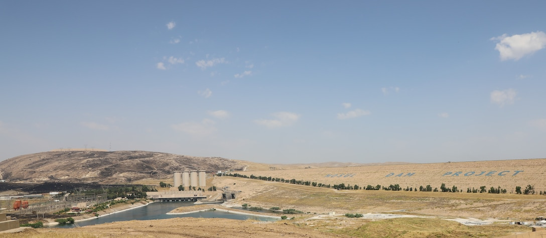 The Mosul Dam, with its the hydropower plant and four water storage towers, sits in a valley along the Tigris River approximately 30 miles outside Mosul City in Iraq. The dam is the largest in Iraq, and the fourth largest in the Middle East. It supplies water, hydropower, irrigation and flood control to the region.