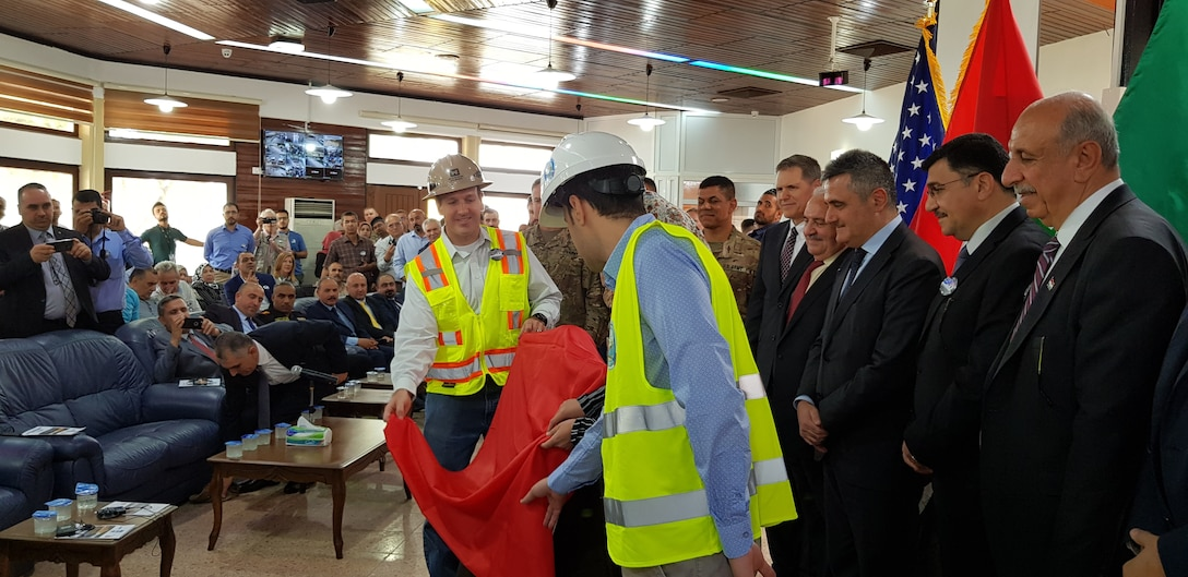 Italian Ambassador to Iraq Bruno Pasquino, Iraq Minister of Water Resources Jamal Abbas al-Adili and U.S. Ambassador to Iraq Matthew H. Tueller view the new plaque that will hang at the Iraqi Ministry of Water Resources building commemorating the 3-year partnership between the three countries. The plaque was unveiled during a ceremony on June 15, 2019, in Mosul Iraq. The Mosul Dam Project started in 2016 as a joint project among the Iraq Ministry of Water Resources, the U.S. Army Corps of Engineers, and Italian Company Trevi S.p.A. in an effort to stabilize the infrastructure of the Mosul Dam. The Dam, which is the largest in Iraq, and the fourth largest in the Middle East, supplies water, hydropower, irrigation and flood control to the region.