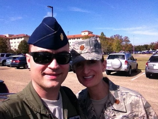 "Col. Lawrence Sullivan, 8th Fighter Wing vice commander, and his wife, Maj. Teresa Sullivan, a public affairs officer at Headquarters Air Force Staff, pose for a picture October 2013, at Maxwell Air Force Base, Ala. Col. Sullivan is joining the 8th FW ""Wolf Pack"" after a tour at the Special Projects and Innovation Division, Pentagon, Arlington, Va. His tour at Kunsan Air Base, Republic of Korea, is the fifth time he has been stationed within Pacific Air Forces Command. (Courtesy Photo)"