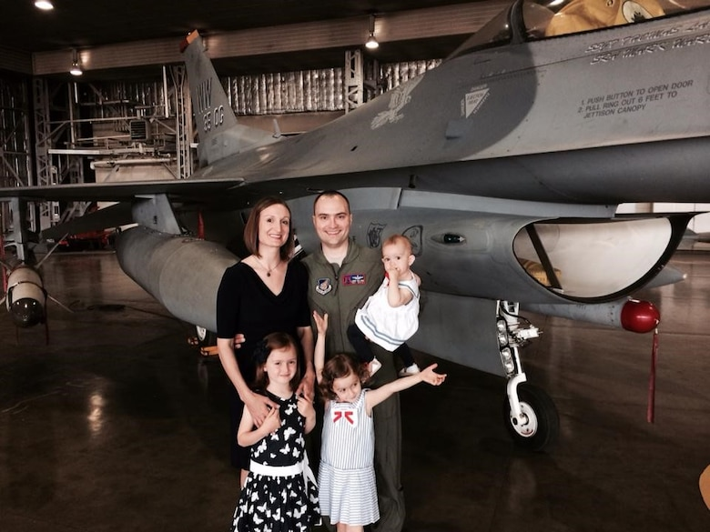 Col. Lawrence Sullivan, 8th Fighter Wing vice commander, and his wife, Maj. Teresa Sullivan, pose for a family photo with their three daughters in May 2015, at Misawa Air Base, Japan. During Sullivan's short tour at Kunsan Air Base, Republic of Korea, Maj. Sullivan continues to serve as a public affairs officer for Headquarter Air Force Staff, Pentagon, Va., while also providing care for their children at home. Sullivan says her support helps him to be able to play a key role in a wing consisting of more than 2,700 active-duty personnel, four groups, and 13 squadrons, including two F-16 Fighting Falcon squadrons. (Courtesy Photo)