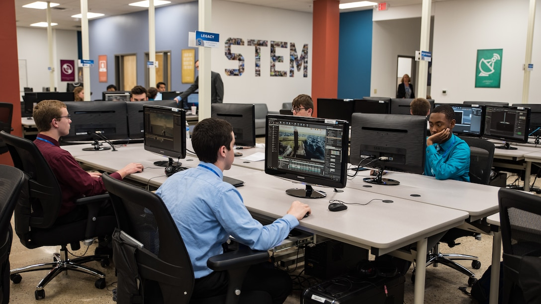 Air Force Research Laboratory Legacy interns work on their projects in the new Gaming Research Integration and Learning Laboratory (GRILL) space prior to the ribbon-cutting ceremony June 7 at the Dayton Regional STEM School. (U.S. Air Force photo/Richard Eldridge)