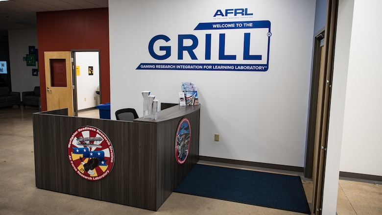 The front desk and entrance of the new Air Force Research Laboratory's Gaming Research Integration and Learning Laboratory (GRILL) was shown to attendees after the ribbon-cutting ceremony at the Dayton Regional STEM School June 7. (U.S. Air Force photo/Richard Eldridge)