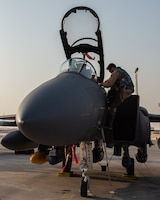 Maintainers newly assigned to the 380th Expeditionary Aircraft Maintenance Squadron, assist pilots arriving from the 336th Fighter Squadron, June 13, 2019, at Al Dhafra Air Base, United Arab Emirates. The aircrew and maintainers deployed from the 4th Fighter Wing at Seymour Johnson Air Force Base, North Carolina, to join Team ADAB's diverse inventory of air power. (U.S. Air Force photo by Staff Sgt. Chris Thornbury)