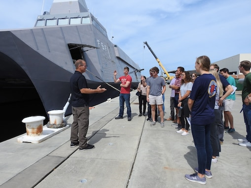 Naval Research Enterprise Internship Program (NREIP) interns toured Naval Surface Warfare Center Panama City Division's (NSWC PCD) various facilities to learn more about the opportunities to work with many projects and mission areas at NSWC PCD June 13.