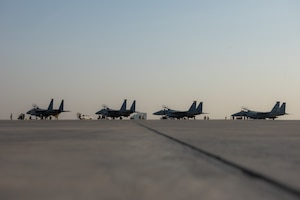 Four F-15E Strike Eagles from the 336th Fighter Squadron, 4th Fighter Wing at Seymour Johnson Air Force Base, North Carolina sit on the airfield at Al Dhafra Air Base, United Arab Emirates, June 13, 2019. The F-15E's joined ADABs inventory of other fighters to include F-15C Eagles and F-35A Lightning IIs. (U.S. Air Force photo by Staff Sgt. Chris Thornbury)