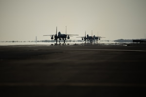 Three F-15E Strike Eagles from the 336th Fighter Squadron, 4th Fighter Wing at Seymour Johnson Air Force Base, North Carolina taxi the runway at Al Dhafra Air Base, United Arab Emirates, June 14, 2019. The F-15E's joined ADABs inventory of other fighters to include F-15C Eagles and F-35A Lightning IIs. (U.S. Air Force photo by Staff Sgt. Chris Thornbury)
