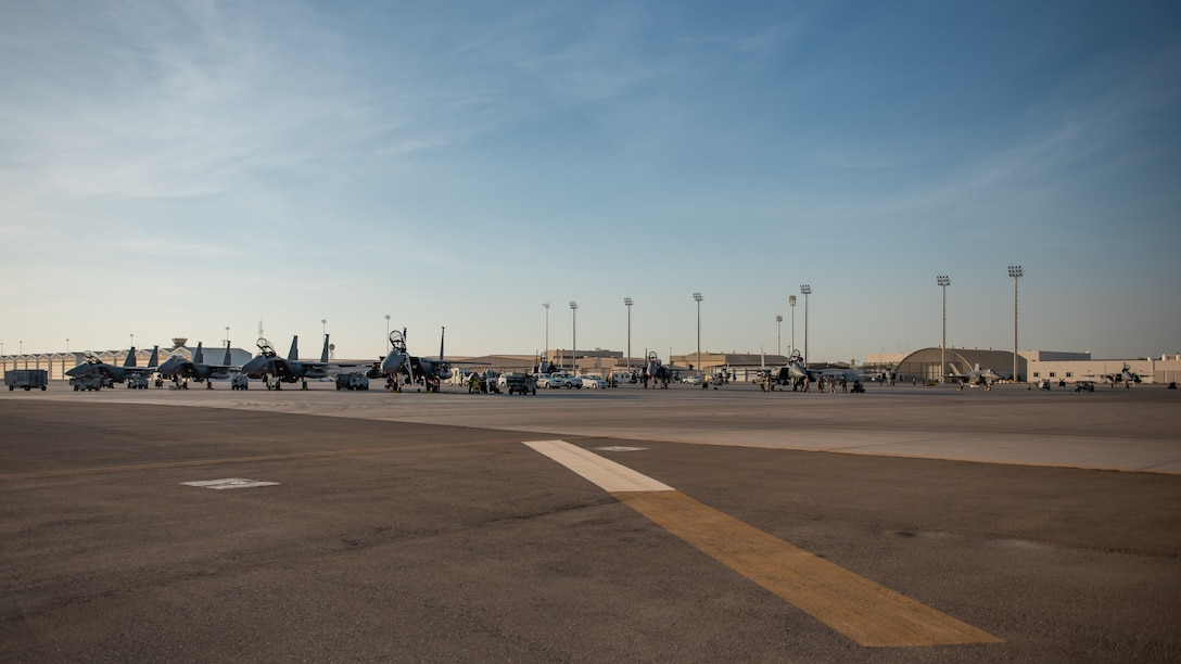 Seven F-15E Strike Eagles from the 336th Fighter Squadron, 4th Fighter Wing at Seymour Johnson Air Force Base, North Carolina sit on the airfield at Al Dhafra Air Base, United Arab Emirates, June 14, 2019. The F-15E's joined ADABs inventory of other fighters to include F-15C Eagles and F-35A Lightning IIs. (U.S. Air Force photo by Staff Sgt. Chris Thornbury)