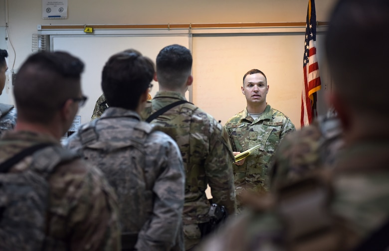Master Sgt. Michael Alberti, 39th Security Forces Squadron Delta Flight chief, briefs Airmen during guard mount April 4, 2019, at Incirlik Air Base, Turkey. Guard mount takes place prior to Airmen reporting to their assigned post for their shift and gives flight leadership the opportunity to pertinent information. (U.S. Air Force photo by Staff Sgt. Trevor Rhynes)