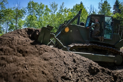 U.S. Marines with MWSS-471 build a roadway at Canadian Forces Base Cold Lake