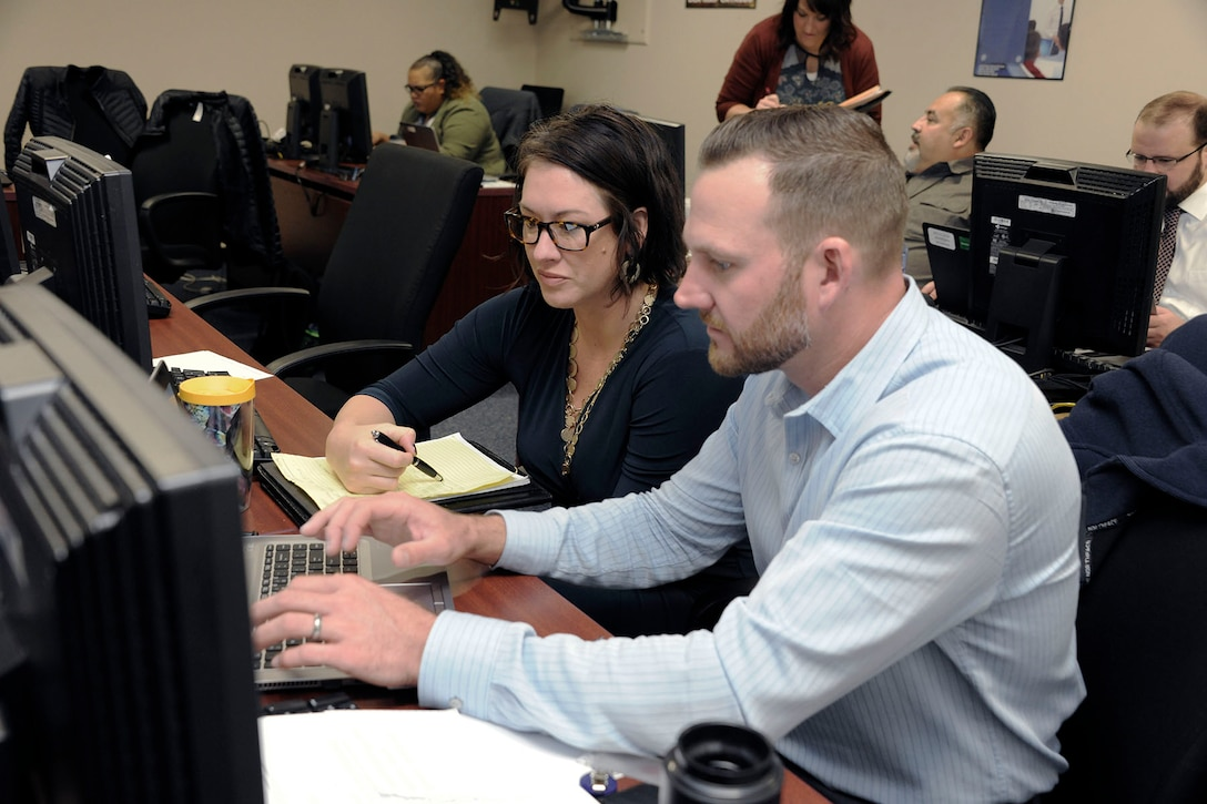 Amber Gentry-Upston, HAZMAT program manager for DLA Information Operations, works with a user during the testing.