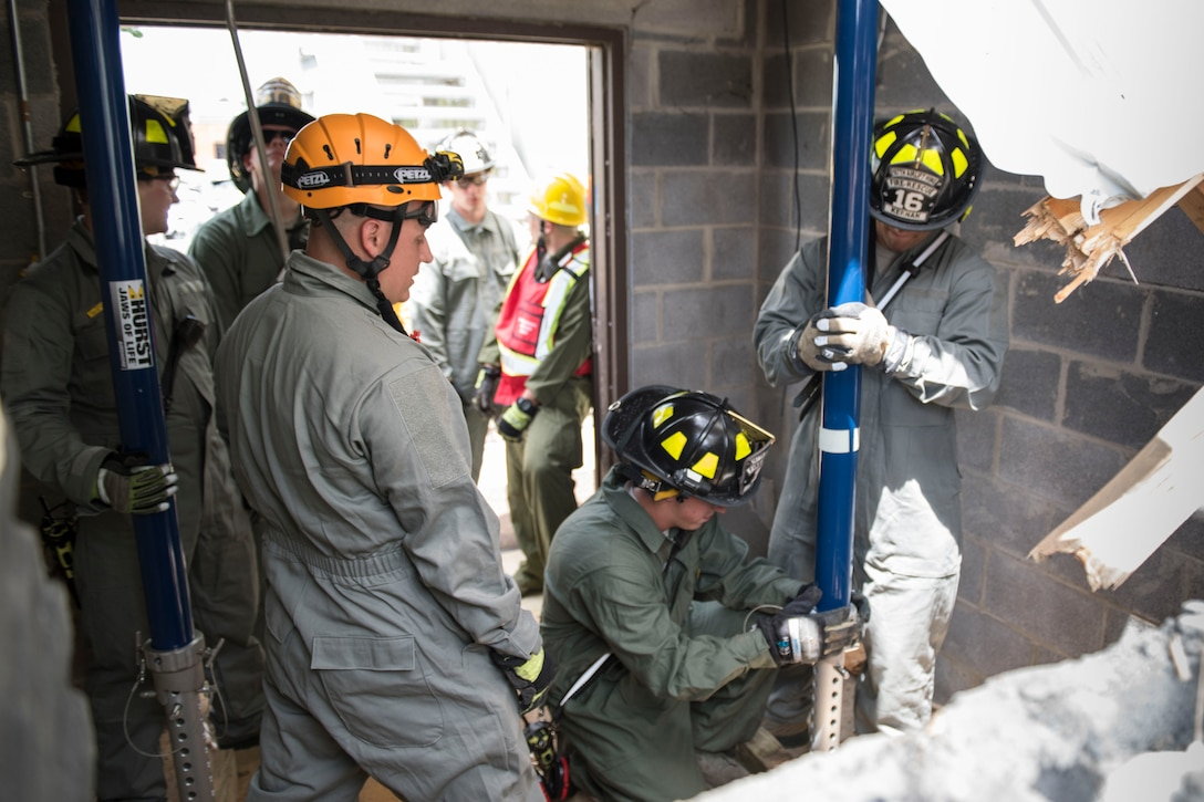Firefighter's with the 167th Airlift Wing, Martinsburg, WV, practice proper shoring techniques to prevent structural collapse of a building during June 2019 Super Drill.  The drill incorporated different facets of their job to include, responding to the location, scene size-up, simulated patient extraction and structural shoring (stabilization) techniques. (U.S. Air National Guard photo by Tech. Sgt. Michael Dickson)