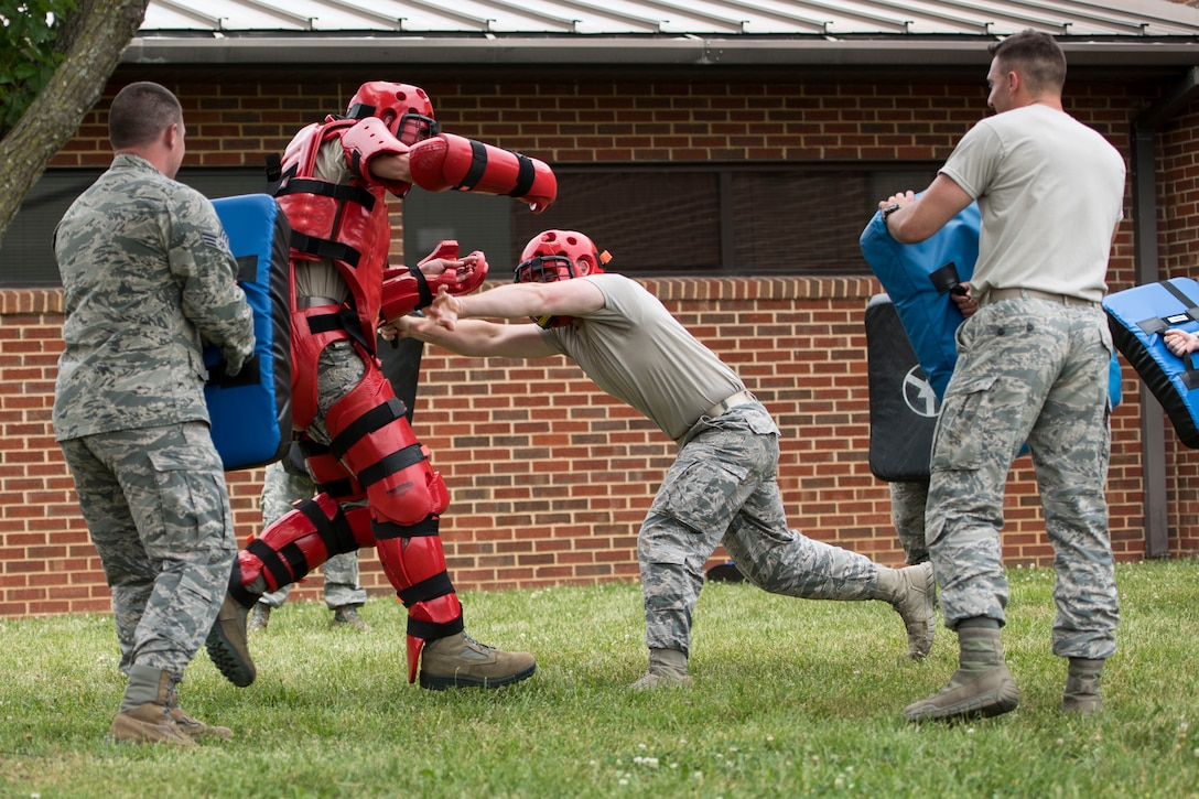"""Members of the 167th Security Forces participated in """"Redman"""" training in front of the dining facilityat the 167th Airlift WIng, martinsburg, W.Va.,  June 7, 2019. During the training, security forces members practiced striking and blocking against the """"Redman."""" (U.S. Air National Guard photo by Tech. Sgt. Jodie Witmer)"""