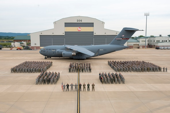 The 167th Airlift Wing stands in formation on the flightline in front of an aircraft hanger at the 167th AW in Martinsburg, W.Va., June 8, 2019. The wing photo was coordinated as part of the unit's extended training assembly. (U.S. Air National Guard photo by Tech. Sgt. Michael Dickson)